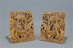 A pair of chinese carved wooden bookends. height