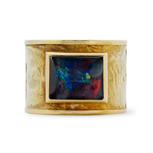 Gerald Benney - an 18ct gold opal doublet ring.