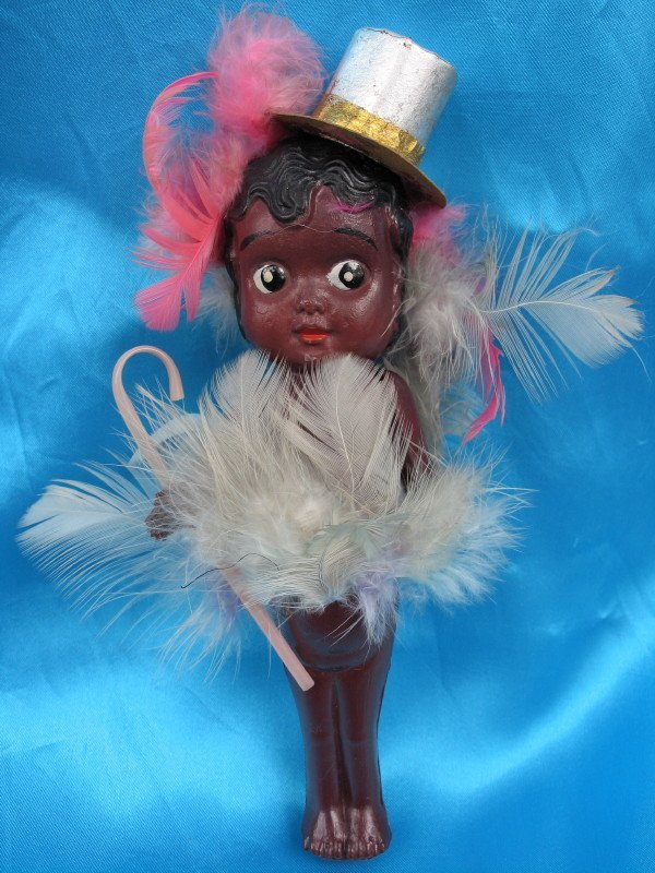 11. Three Celluloid dolls:- 30s Easter toys / carnival