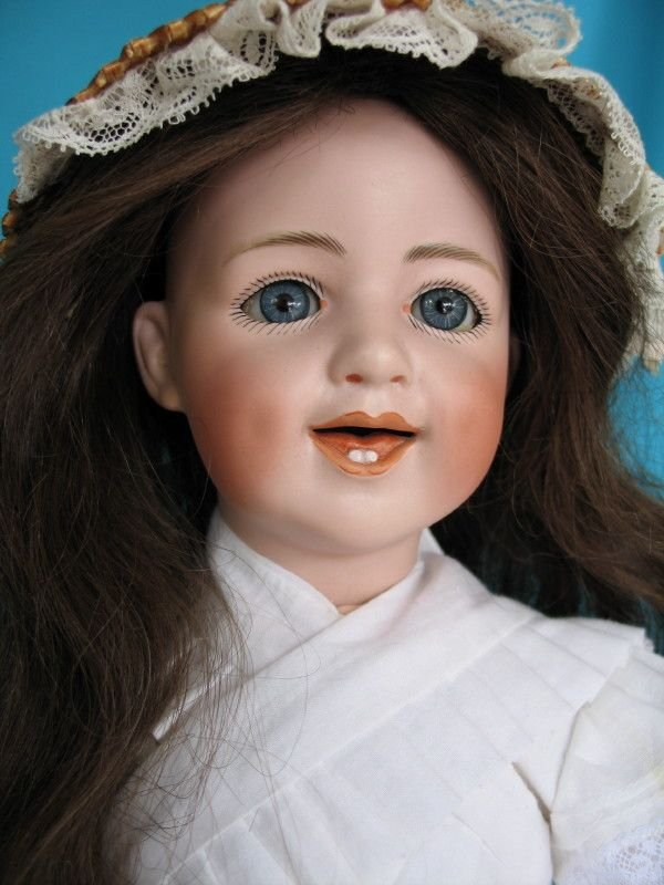 97. Pink bisque doll Gebruder Heubach Laughing Child