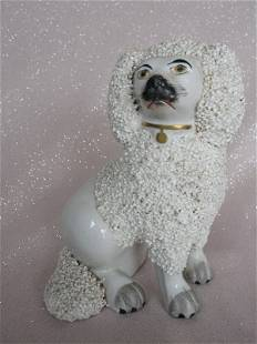 Antique Staffordshire Poodle 14cm. Seated on hind legs