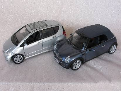 Two diecast 1/18 scale cars:- Kyosho Mini Cooper