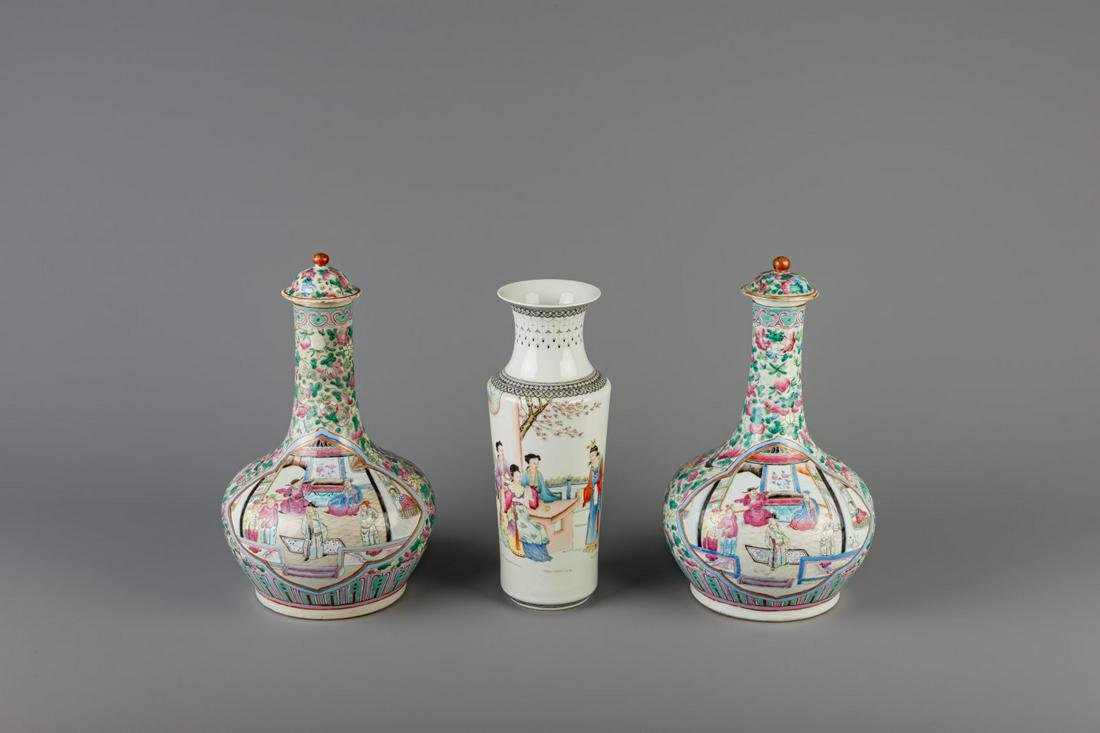 A pair of Chinese famille rose bottle vases and a