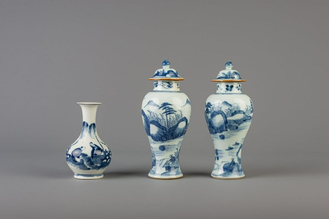 A pair of Chinese blue and white vases and covers and a