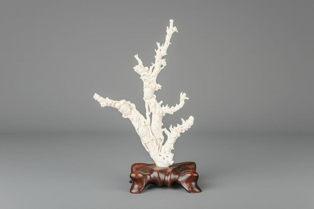 A Chinese carved white coral group depicting two ladies