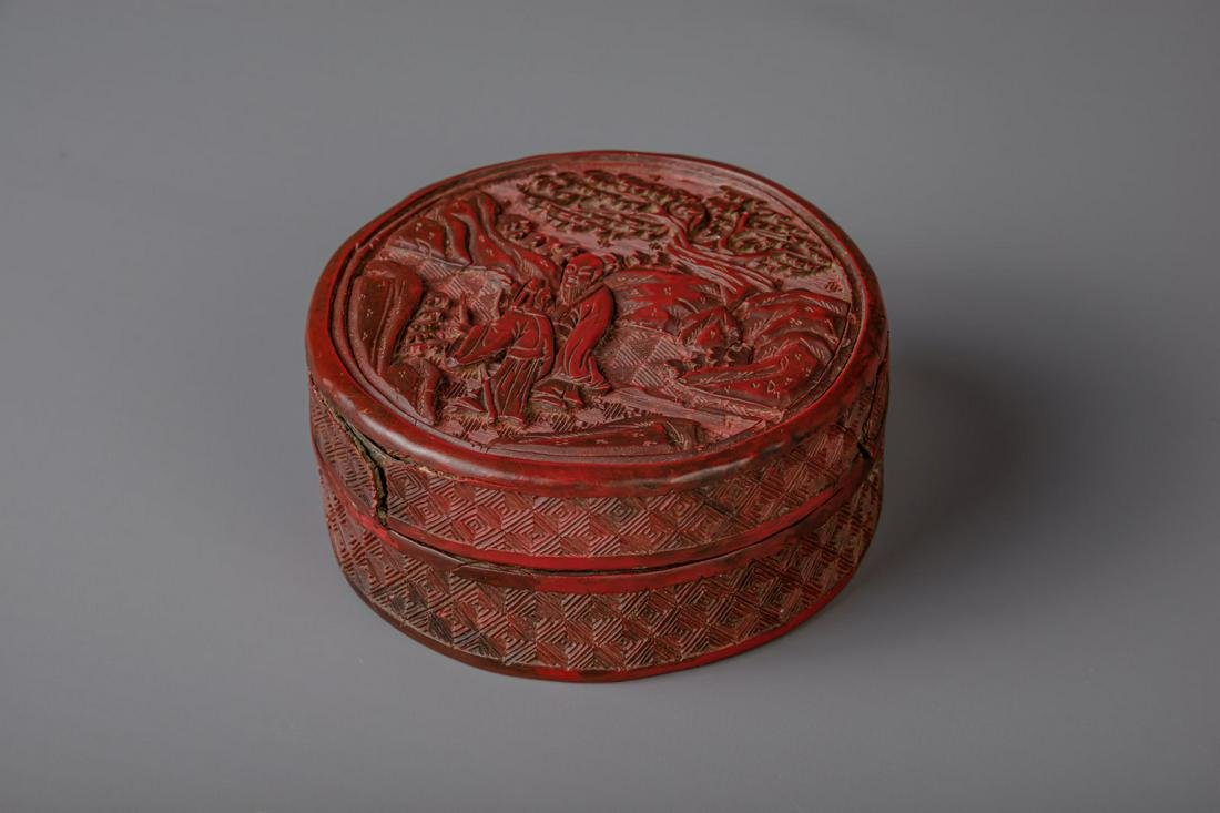 A Chinese carved cinnabar lacquer circular box and