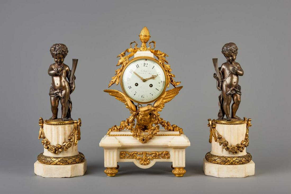 A Neoclassical three-piece gilt bronze mounted and