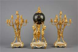 A large and impressive threepiece gilt bronze and