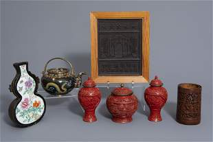 A varied collection Chinese items: a tea block, a