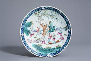 A Chinese famille rose charger with playing boys in a