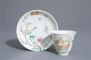 A Chinese famille rose cup and a saucer with different