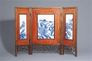 A Chinese threefold wooden screen with blue and white
