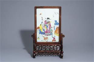A Chinese wooden table screen with a famille rose
