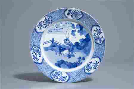 A Chinese blue and white dish with a shepherd, Kangxi