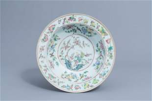A Chinese famille rose bowl with birds among blossoming