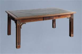 An English George II mahogany library table with a gilt