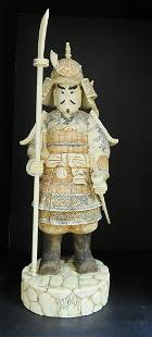 Hand Carved Warrior with Weapons Figurine