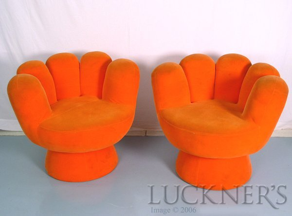 22: A Pair of Orange Hand-Shaped Chairs
