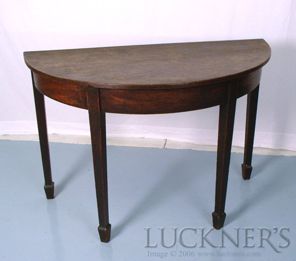 1014: A George III Demi Lune Table