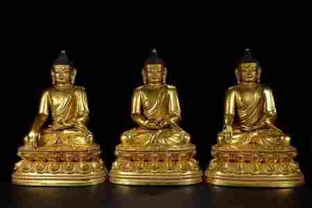 XUANDE MARK GILT BRONZE BUDDHAS OF THREE PERIODS