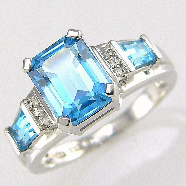 3005: 10KW DIA BLUE TOPAZ-9X7MM RING SZ 7