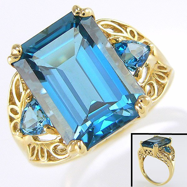 2111: 10KY BLUE TOPAZ -14X10MM RING SZ 6