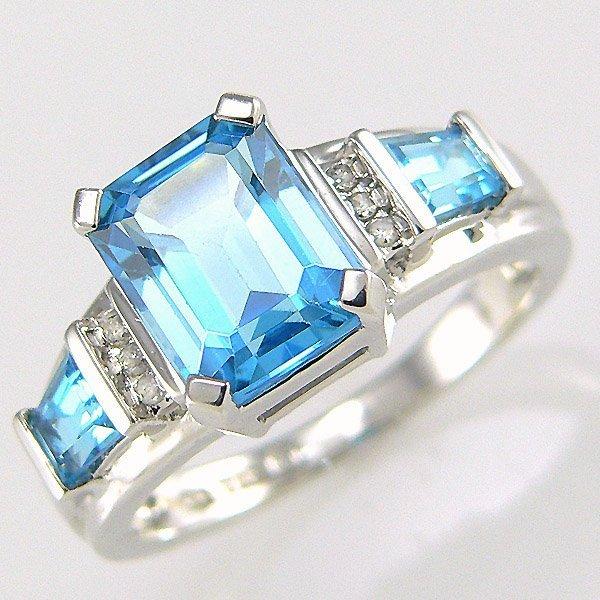 3005: 10KW DIA BLUE TOPAZ-9X7MM RING SZ 7