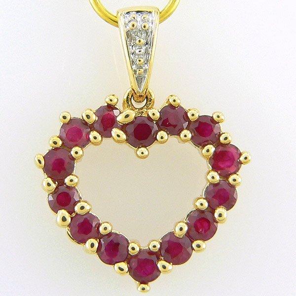 201100003: 10KT RUBY DIAMOND HEART PENDANT 0.84TCW