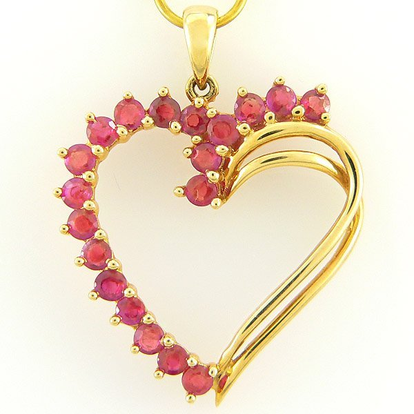 1401100012: 14KT RUBY HEART PENDANT 1.02CTS