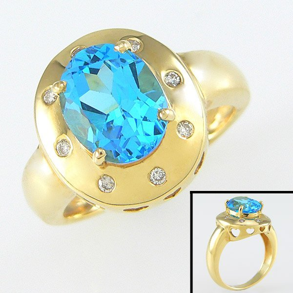 205101528: 14KT DIA BLUE TOPAZ-10X8MM RING SZ 7