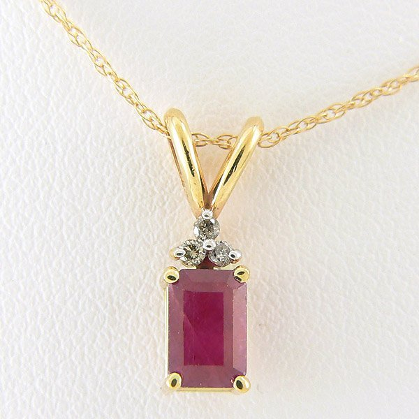 40027: DIAMOND RUBY PENDANT 0.66TCW 14KT