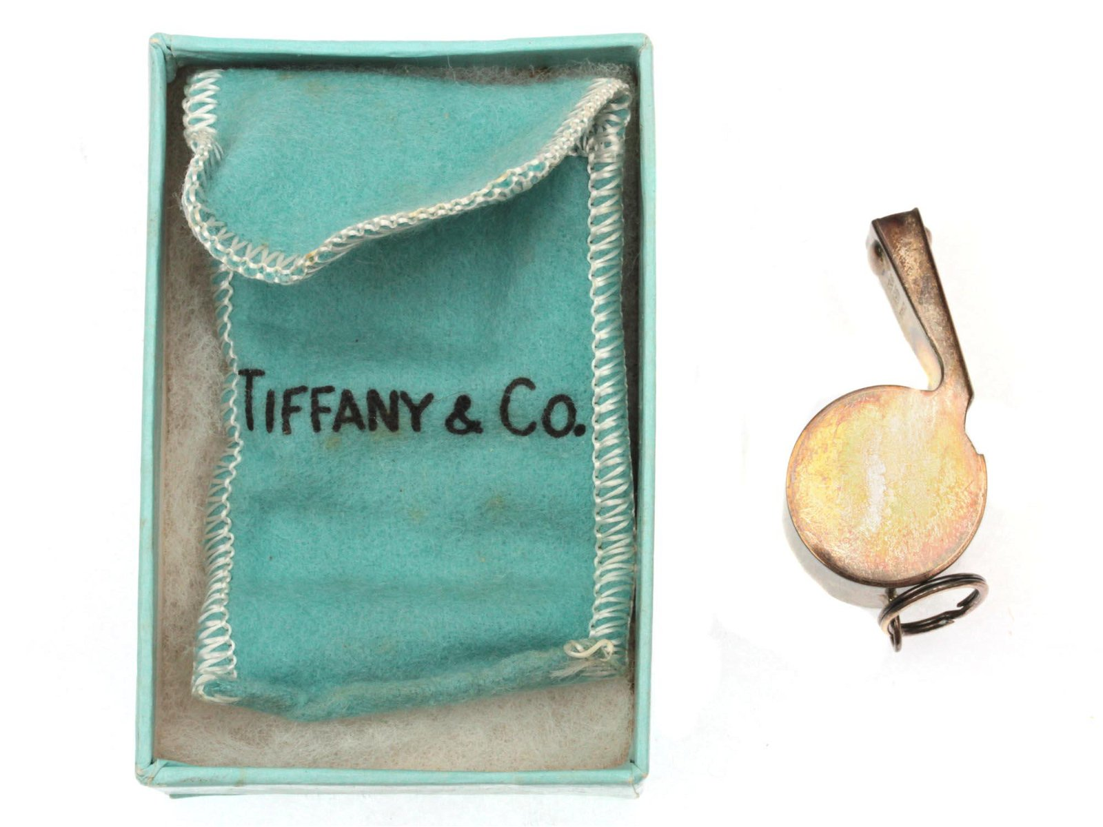 A VINTAGE TIFFANY & CO. STERLING SILVER WHISTLE