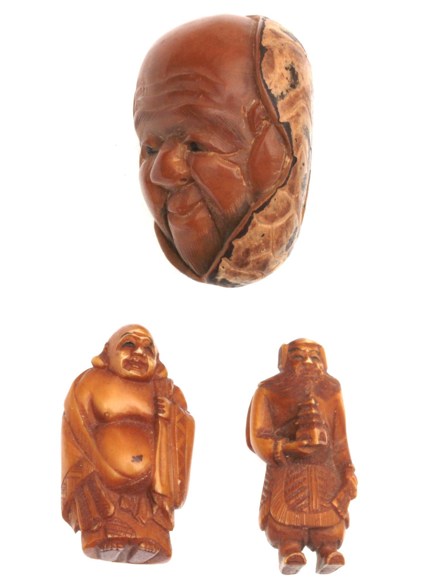 A SET OF THREE JAPANESE CARVED HORN NETSUKE