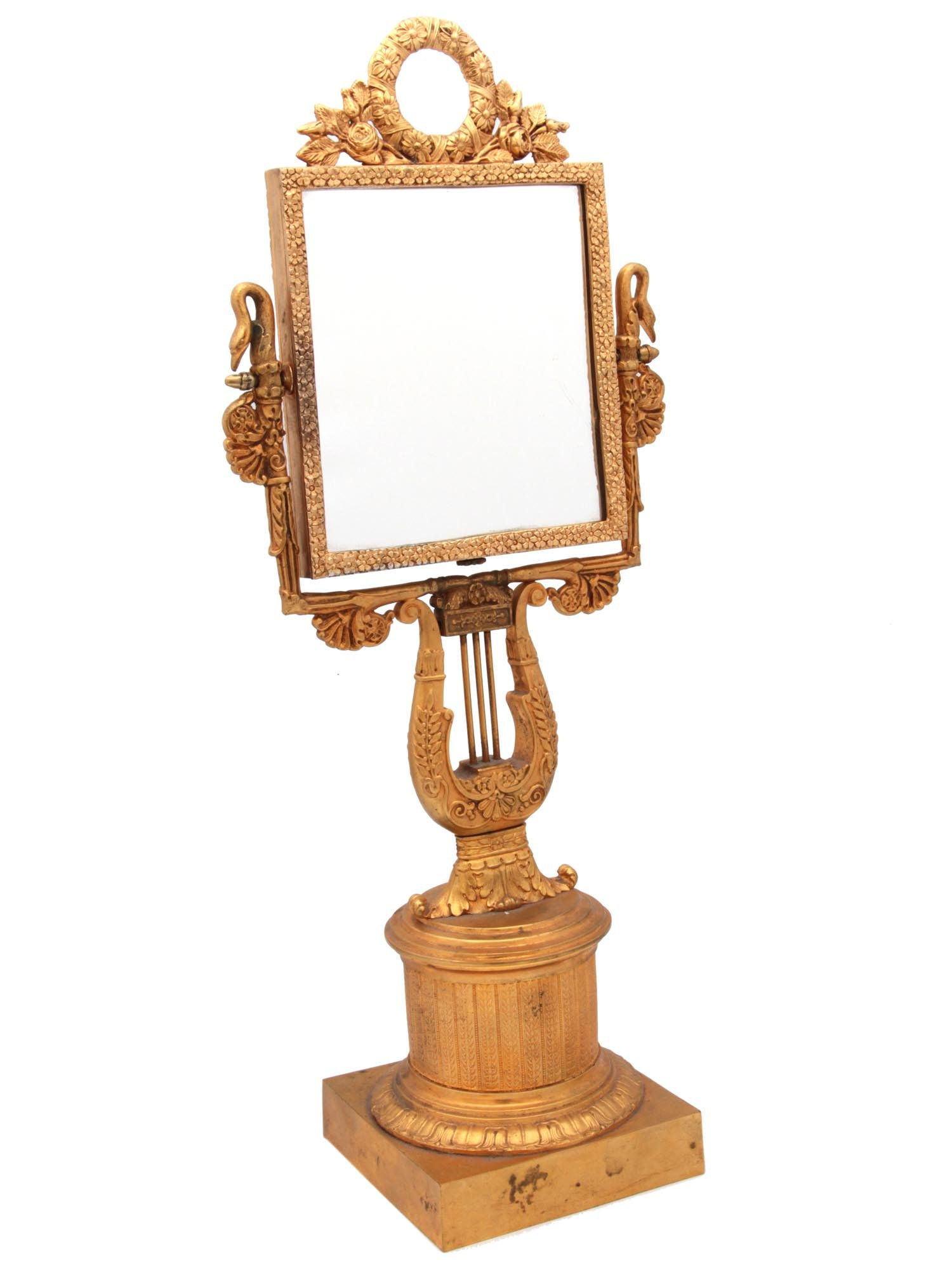 AN ANTIQUE FRENCH GILDED BRONZE MIRROR