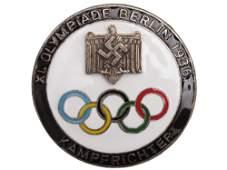 A GERMAN 3RD REICH 1936 OLYMPICS ENAMELED BADGE