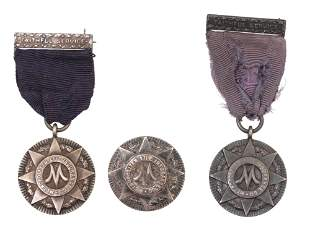 TWO SILVER MEDALS AND ONE BADGE BY TIFFANY & CO