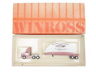 A WINROSS MODEL FLATBED TRAILER TRUCK WITH LOGOS