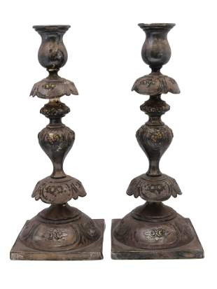 A RUSSIAN ANTIQUE SILVER PLATED CANDLESTICKS
