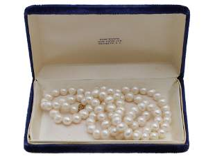 A VINTAGE PEARL NECKLACE WITH 14K GOLD CLASP