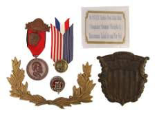 A SET OF ANTIQUE BADGES AND A CARD 6 PIECES