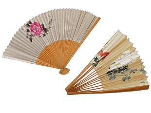 A PAIR OF ANTIQUE JAPANESE FOLDING HAND FANS
