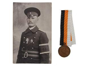 A RUSSIAN IMPERIAL MEDLA WITH PHOTOGRAPH