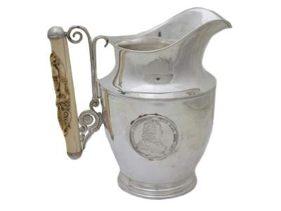 A RUSSIAN 84 SILVER WATER PITCHER WITH MEDALS