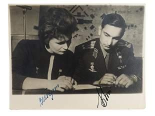 A VINTAGE SIGNED PHOTO OF SOVIET COSMONAUTS