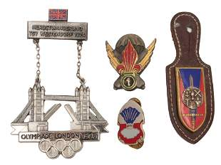 A LOT OF FOUR ANTIQUE MILITARY AND OLYMPIC BADGES