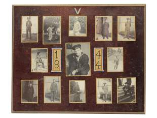A VINTAGE WOODEN PANEL WITH WWII PHOTOGRAPHS