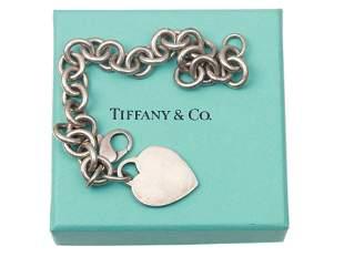 A VINTAGE TIFFANY & CO. HEART TAG CHARM BRACELET