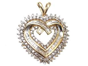 A VINTAGE JEWELRY 10K GOLD PENDANT WITH DIAMONDS