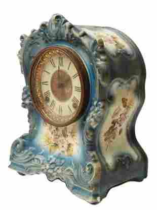 AN ANTIQUE ANSONIA PORCELAIN MANTEL CLOCK, TORN