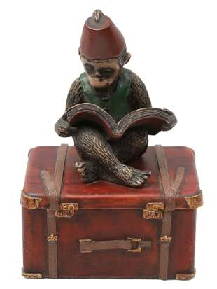 A VINTAGE TRINKET BOX WITH A READING MONKEY